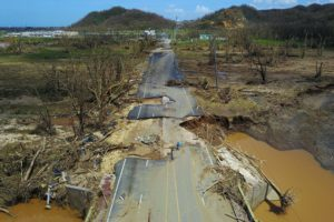 A damaged road in Toa Alta, west of San Juan, Puerto Rico, photographed on September 24, 2017 following the passage of Hurricane Maria. Photo by Ricardo Arduengo AFP/Getty Images