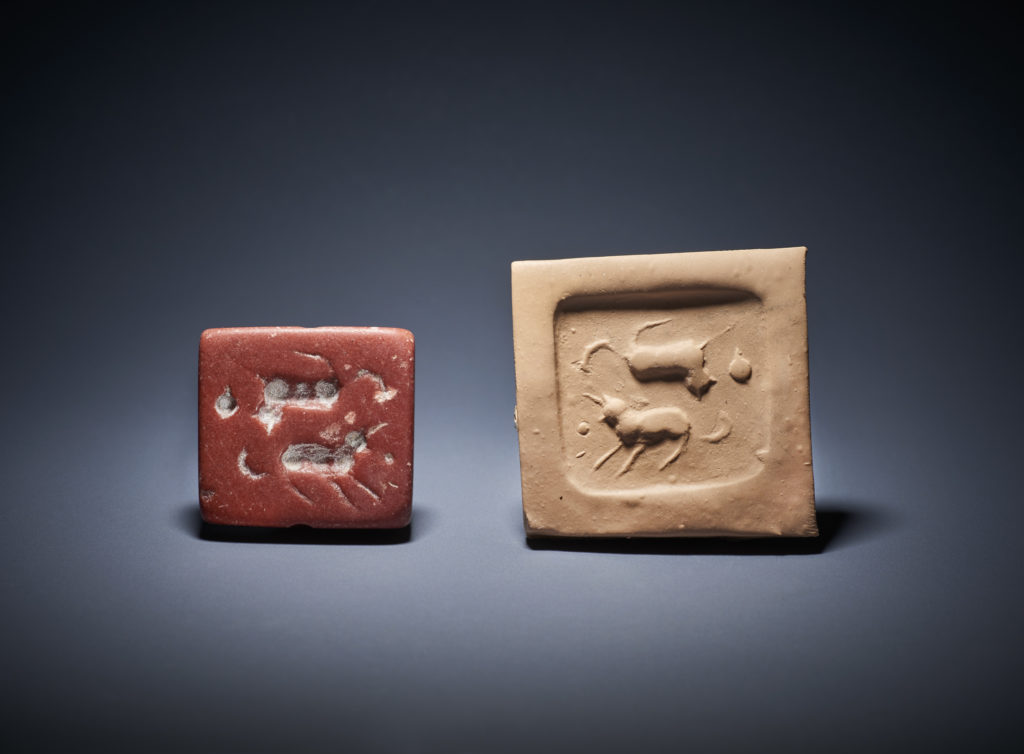 A red marble square tabular stamp seal and amulet pendant dates to the Jemdet Nasr period (c. 3,000 BC). Photo courtesy of the British Museum