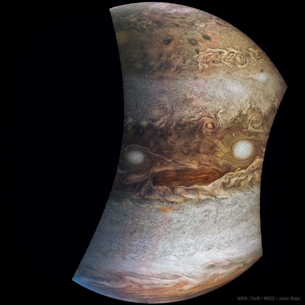 "One photo, rotated 180 degrees, reveals the ""face of Jupiter,"" jokingly named ""Jovey McJupiterface."" Photo by NASA / SwRI / Jason Major"