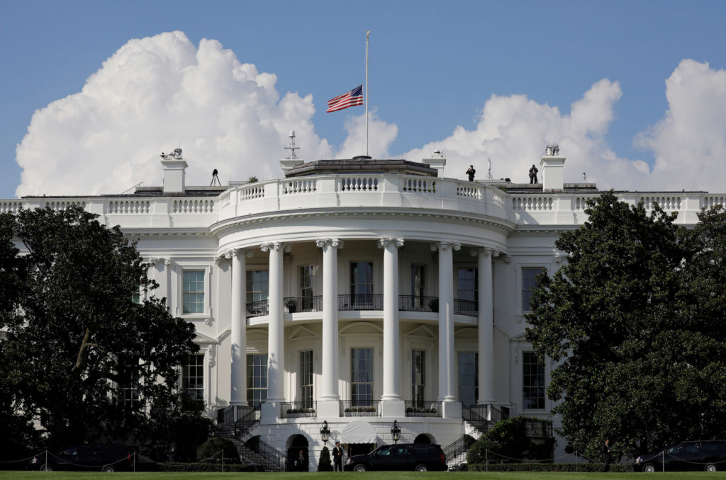 U.S. flag is seen at half-mast at the White House, as President Don…
