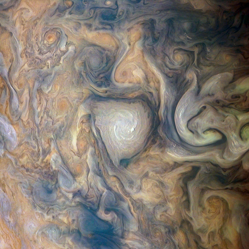 A mathematician from Germany turned raw data from JunoCam into an image of a swirling storm on Jupiter's surface, and an artist from London brought it to life with color. Photo by NASA / SwRI / MSSS / Gerald Eichstädt / Seán Doran