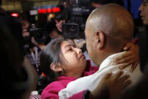 Mario Vargas-Lopez and his 10-year-old daughter, Jersey, who traveled to the Vatican to plead with Pope Francis for help to prevent his deportation, hug as they are reunited at Los Angeles International Airport in Los Angeles, California, March 29, 2014. Photo by David McNew/Reuters