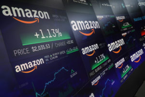 The Amazon.com logo and stock price information is seen on screens at the Nasdaq Market Site in New York City, New York, U.S., September 4, 2018. REUTERS/Mike Segar