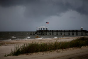 Storm clouds loom over a pier as Tropical Storm Gordon approaches in Waveland, Mississippi. Photo by Jonathan Bachman/Reuters