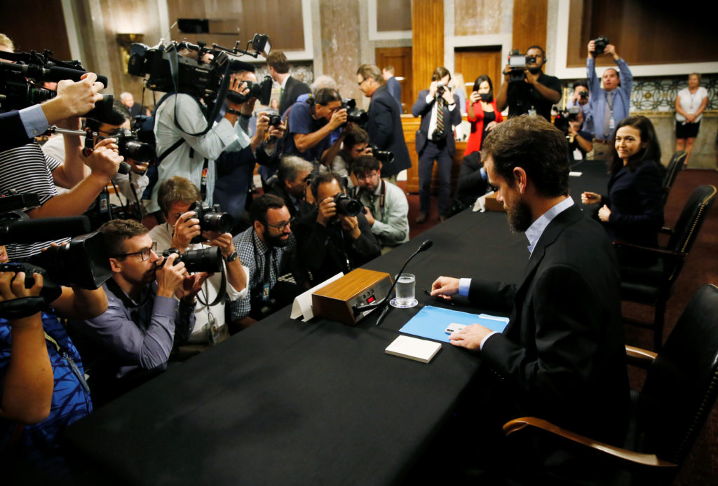 Twitter CEO Jack Dorsey and Facebook COO Sheryl Sandberg are seated to testify before a Senate Intelligence Committee hearing on foreign influence operations on social media platforms on Capitol Hill in Washington, D.C. Photo by Jim Bourg/Reuters