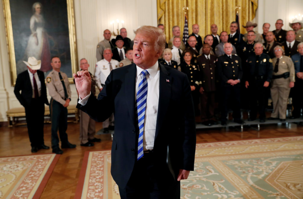 U.S. President Donald Trump addresses the news media directly as he speaks on a range of topics following a meeting with sheriffs from across the country at the White House in Washington, U.S., September 5, 2018. REUTERS/Leah Millis - RC18ED5AF870