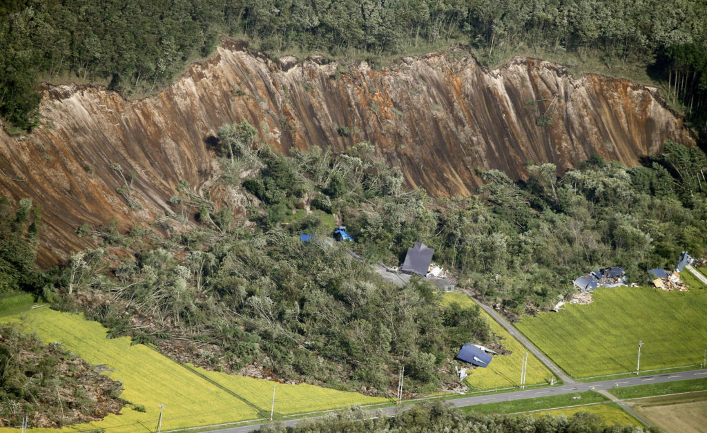 A landslide wiped out several houses in Atsuma town in Japan's northern island of Hokkaido on Sept. 6. The earthquake also knocked out power to about 5 million residents. Photo by Kyodo/via Reuters