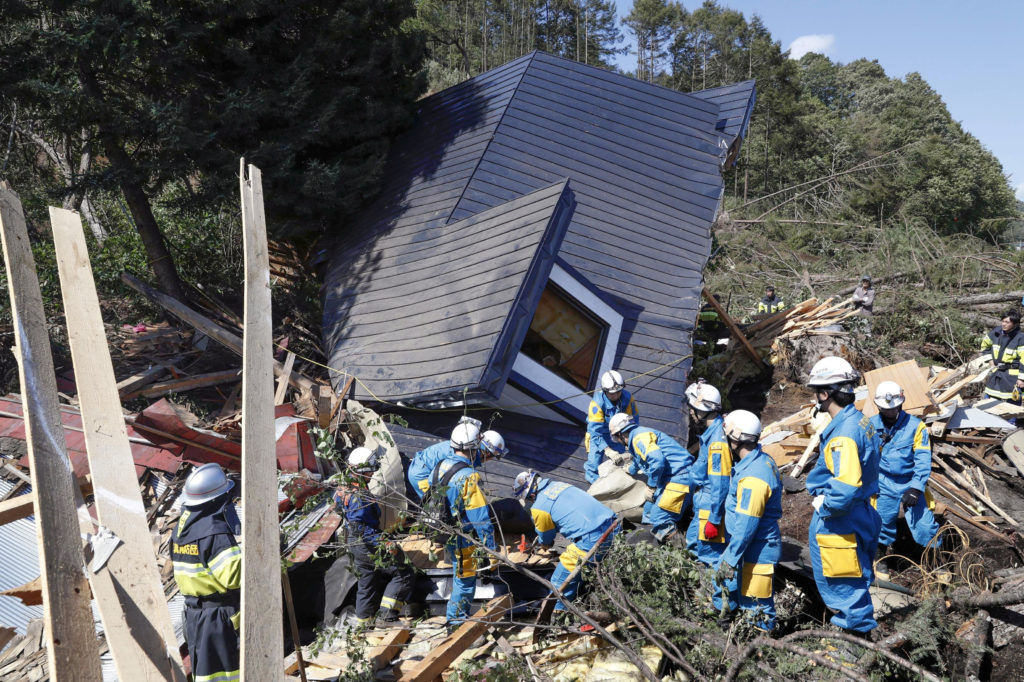 Rescue workers search for survivors from a house damaged by a landslide caused by an earthquake in Atsuma town, Hokkaido, Japan on Sept. 6. Photo by Kyodo/via Reuters