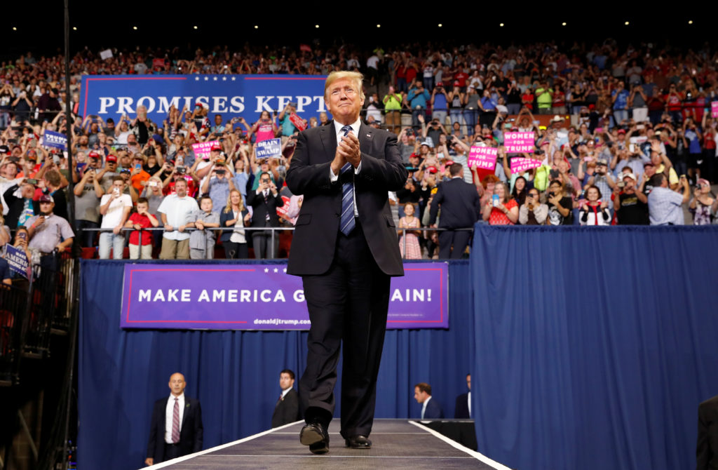 """President Donald Trump greets the crowd as he arrives for a """"Make America Great Again"""" rally in Billings, Montana. Photo b..."""