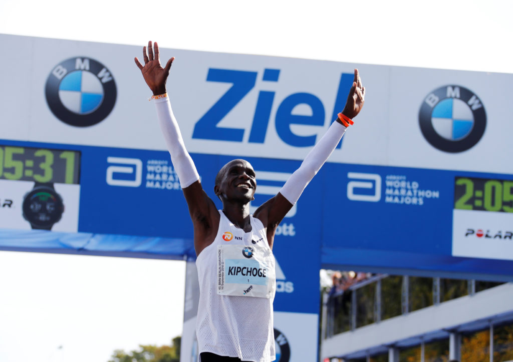Kenya's Eliud Kipchoge celebrates winning the Berlin Marathon and breaking the World Record. Photo by Fabrizio Bensch/Reuters
