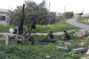 Ansar Al-Sham Brigade fighters rest with their weapons near Jisr al-Shoghour, Idlib province, Syria on March 25, 2015. File photo by Mohamad Bayoush/Reuters
