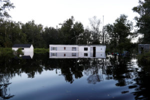 A mobile home is surrounded by flood waters in the aftermath of Hurricane Florence in Fair Bluff, North Carolina. Photo by Randall Hill/Reuters