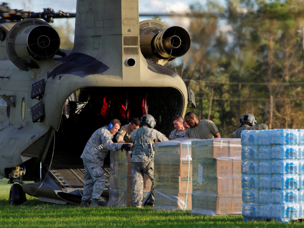 U.S. Army personnel unload food and water from a CH-47 Chinook helicopter for a community isolated by the effects of Hurricane Florence, now downgraded to a tropical depression, in Atkinson, North Carolina, on Sept. 18. Photo by Jonathan Drake/Reuters