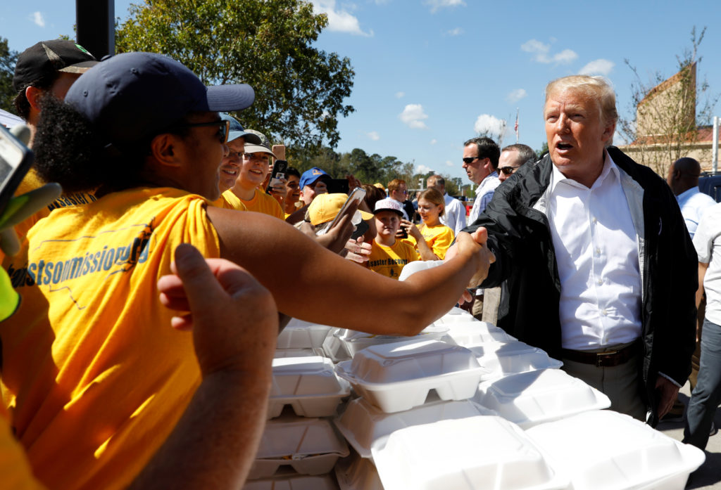 President Donald Trump greets people while distributing food after Hurricane Florence in New Bern, North Carolina, on Sept. 19. Photo by Kevin Lamarque/Reuters