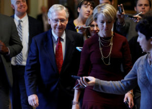"""Senate Majority Leader Mitch McConnell (R-KY) walks to his office on Capitol Hill. McConnell said Monday that Democrats were conducting a """"smear campaign"""" against Supreme Court nominee Brett Kavanaugh. REUTERS/Joshua Roberts"""