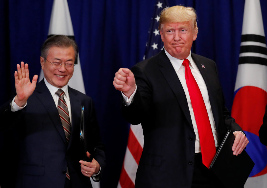 U.S. President Donald Trump and South Korean President Moon Jae-in gesture after signing the U.S.-Korea Free Trade Agreementon during a ceremony on the sidelines of the 73rd United Nations General Assembly in New York on September 24, 2018. REUTERS/Carlos Barria