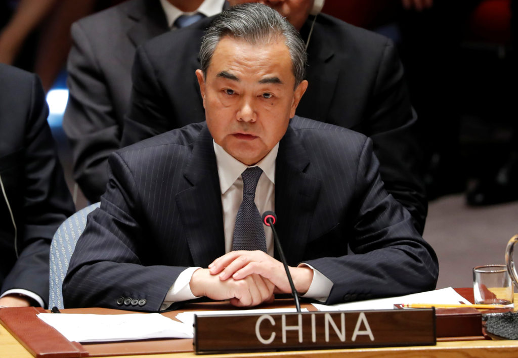China's Foreign Minister Wang Yi listens to U.S. President Donald Trump address a UN Security Council meeting during the 73rd session of the United Nations General Assembly at U.N. headquarters in New York. Photo by Carlos Barria/Reuters