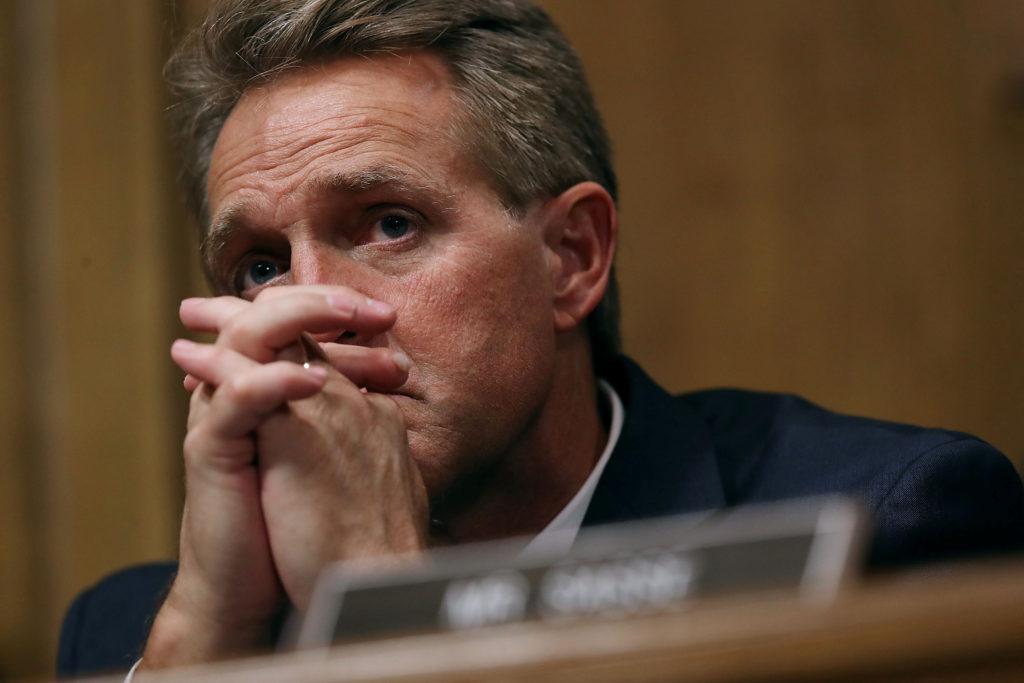 Senate Judiciary Committee member Sen. Jeff Flake (R-Ariz.) listens…