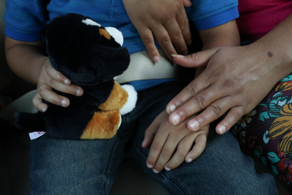 "Dunia, an asylum seeker from Honduras, is reunited with her five-year-old son Wilman at Brownsville South Padre International Airport in Brownsville, Texas, U.S., following their separation of more than five weeks through the Trump administration's ""zero tolerance"" policy. Photo by Loren Elliott/Reuters"