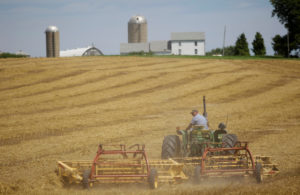 Farmer Mark Klinger harvest his field at his farm in Pecatonica, Illinois, U.S., July 25, 2018. Photo taken July 25, 2018. Photo By Joshua Lott/Reuters
