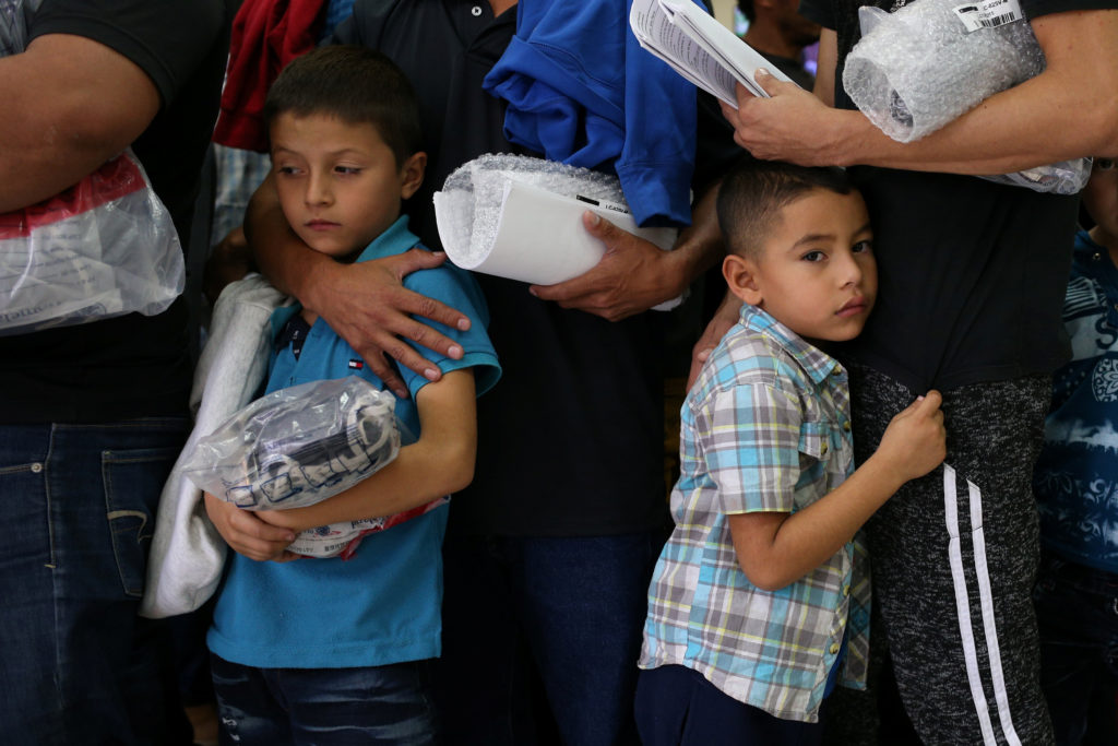 Undocumented immigrant families are released from detention at a bus depot in McAllen, Texas. Photo by Loren Elliott/Reuters