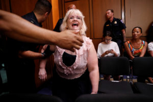 A protester disrupts a Senate Judiciary Committee confirmation hearing for U.S. Supreme Court nominee judge Brett Kavanaugh on Capitol Hill in Washington, U.S., September 4, 2018. REUTERS/Joshua Roberts