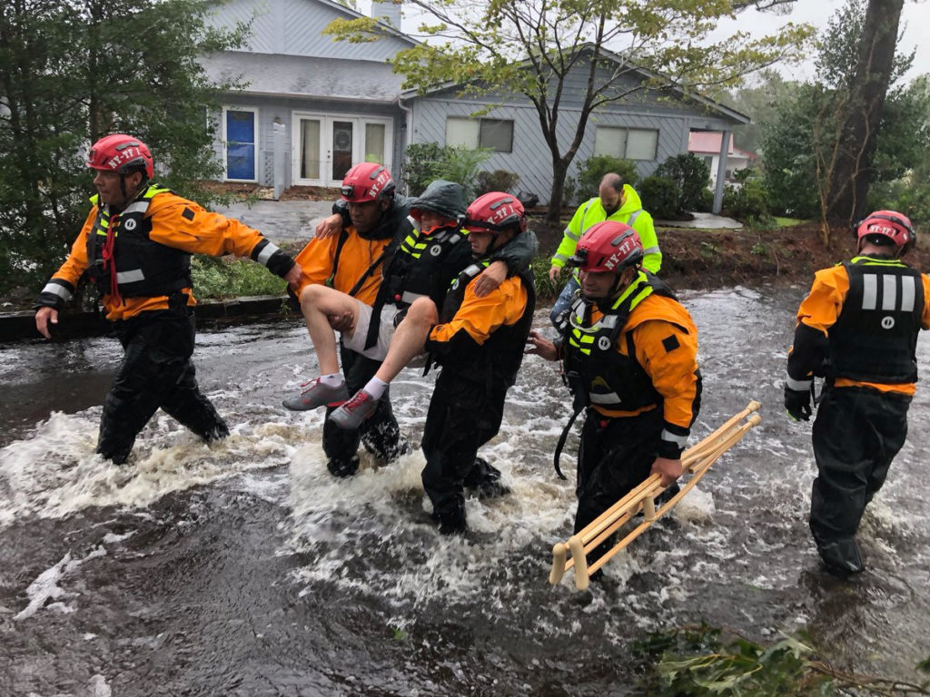 Search and Rescue workers from New York rescue a man from flooding caused by Hurricane Florence in River Bend, North Carolina, U.S. in this September 14, 2018 handout photo. Photo by NYC Emergency Management/Handout via REUTERS