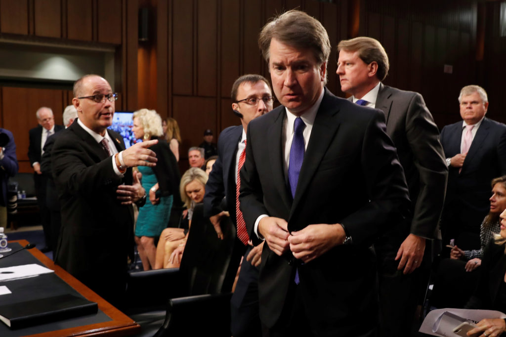Fred Guttenberg (L), the father of Jamie Guttenberg, a victim of the February 14, 2018 mass shooting in Parkland, Florida, reaches out to try to shake hands with U.S. Supreme Court nominee Judge Brett Kavanaugh during his U.S. Senate Judiciary Committee confirmation hearing on Capitol Hill in Washington, U.S., September 4, 2018. REUTERS/Joshua Roberts