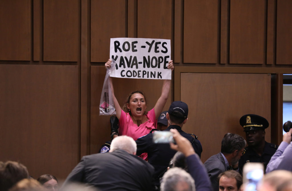 A protester is removed during the start of U.S. Supreme Court nominee judge Brett Kavanaugh's Senate Judiciary Committee confirmation hearing on Capitol Hill in Washington, U.S., September 4, 2018. REUTERS/Chris Wattie