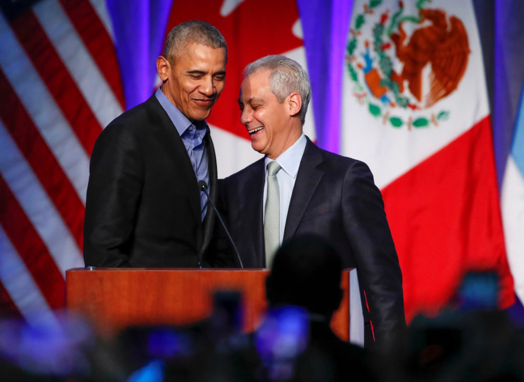 Former U.S. President Barack Obama (L) is greeted on stage by Chicago Mayor Rahm Emanuel (R) before speaking during the North American Climate Summit in Chicago, Illinois, U.S., December 5, 2017. REUTERS/Kamil Krzaczynski