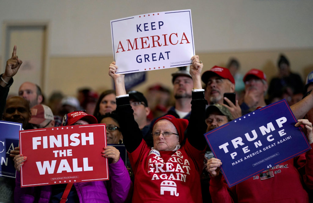 Supporters wave signs before U.S. President Donald Trump arrives to speak at a Make America Great Again rally in Richmond, Kentucky, U.S., October 13, 2018.      Photo by REUTERS/Joshua Roberts