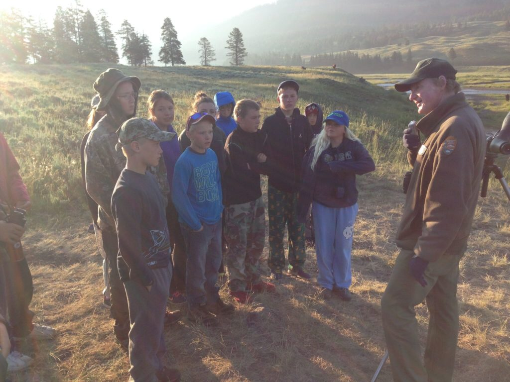 Rick McIntyre talks to kids in Lamar Valley. Credit: Nate Blakeslee