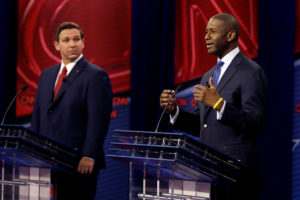 Florida Republican gubernatorial candidate Ron DeSantis (L), looks on during CNN debate with Democratic gubernatorial candidate Andrew Gillum in Tampa, Florida, U.S., October 21, 2018. Photo taken October 21, 2018. Chris O'Meara/Pool via REUTERS - RC1798E8C320