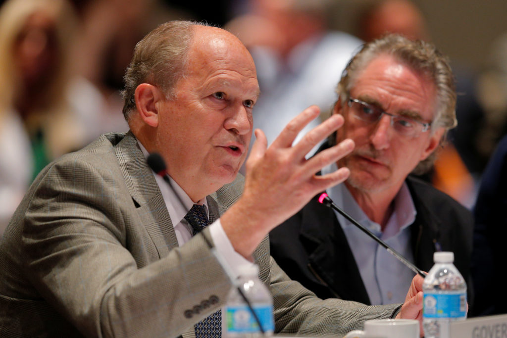 "Alaska Governor Bill Walker (left) speaks, as North Dakota Governor Doug Burgum listens, at the ""Curbing the Opioid Epidemic"" session at the National Governors Association summer meeting in Providence, Rhode Island, U.S., July 13, 2017. Photo by REUTERS/Brian Snyder"