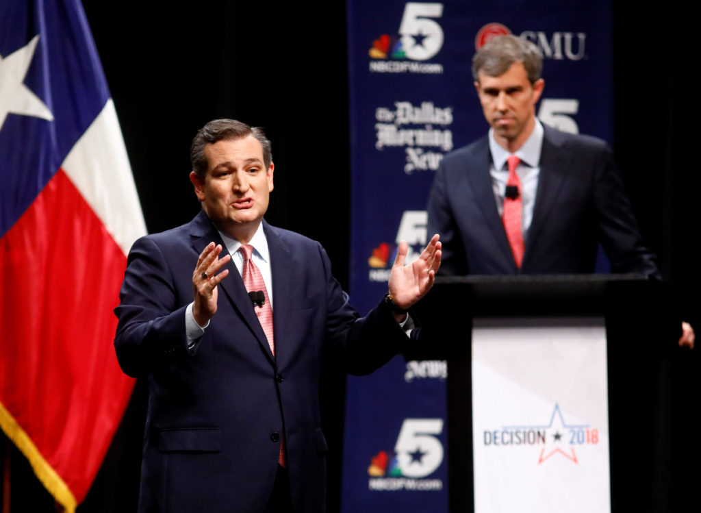 Sen. Ted Cruz (R-TX) makes his final remarks as Rep. Beto O'Rourke (D-TX) listens during a debate for Texas U.S. Senate seat at the Southern Methodist University in Dallas, Texas. Photo by Tom Fox/The Dallas Morning News/Pool via REUTERS