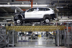 A Bayerische Motoren Werke AG (BMW) sports utility vehicle (SUV) sits on a platform during assembly at the BMW Manufacturing Co. plant in Greer, South Carolina, U.S. on Thursday, May 10, 2018. Markit is scheduled to release manufacturing figures on May 23. Photographer: Luke Sharrett/Bloomberg via Getty Images
