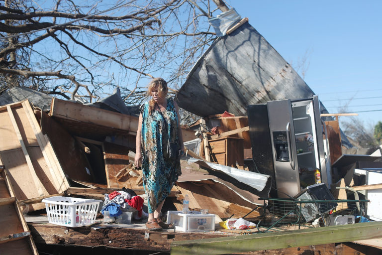 Kathy Coy stands among what is left of her home in Panama City, Florida following Hurricane Michael. Photo by Joe Raedle/Getty Images