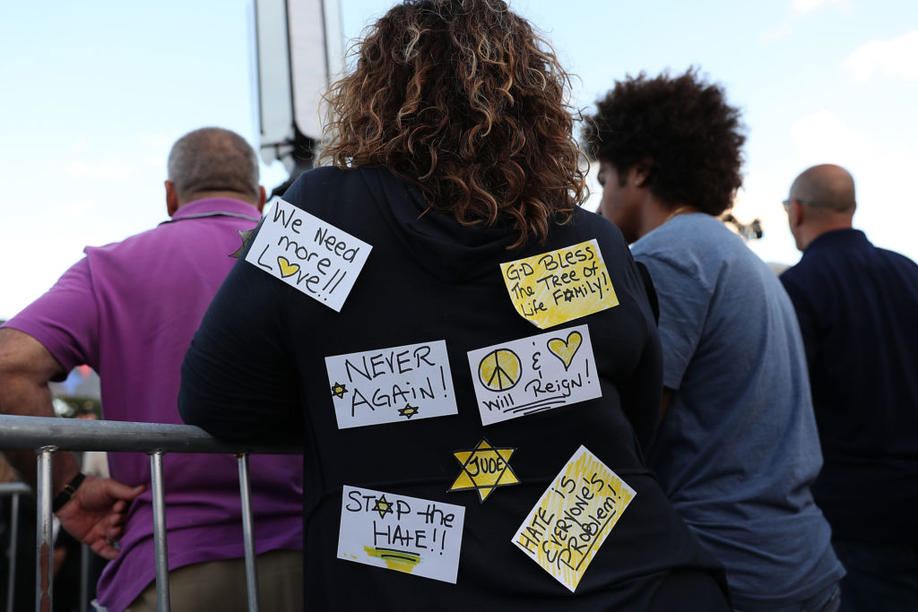 A woman wears handwritten notes on her shirt as she gathers with others for a vigil to remember the victims of the mass shooting at the Tree of Life Congregation in Pittsburgh. Photo by Joe Raedle/Getty Images