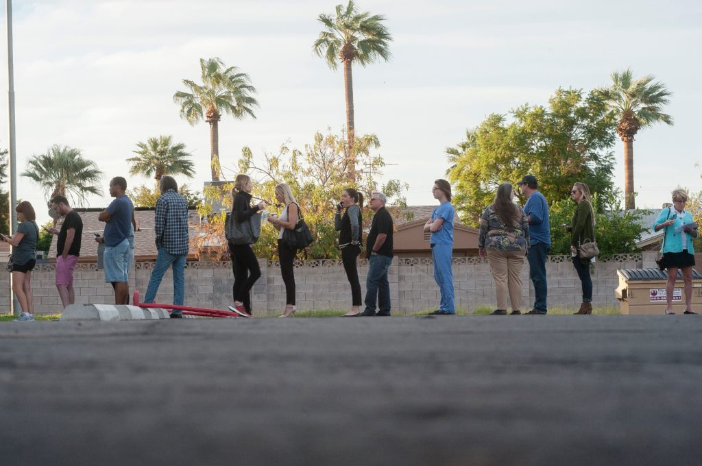 Voters wait in line in front of a polling station to cast their ballots in the US presidential election in Scottsdale, Arizona on November 8, 2016. / AFP / Laura Segall (Photo credit should read LAURA SEGALL/AFP/Getty Images)