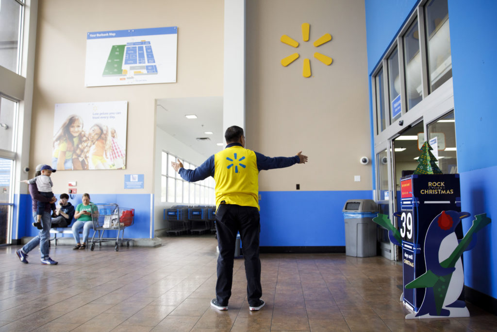 An employee welcomes customers at a Wal-Mart Stores Inc. location in Burbank, California, U.S., on Thursday, Nov. 16, 2017. Black Friday, the day after Thanksgiving, marks the traditional start to the U.S. holiday shopping season. Photographer: Patrick T. Fallon/Bloomberg via Getty Images