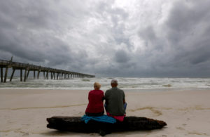 A local couple, who asked not to be named, watch waves come ashore in advance of Hurricane Michael in Pensacola, Florida. Photo by Jonathan Bachman/Reuters
