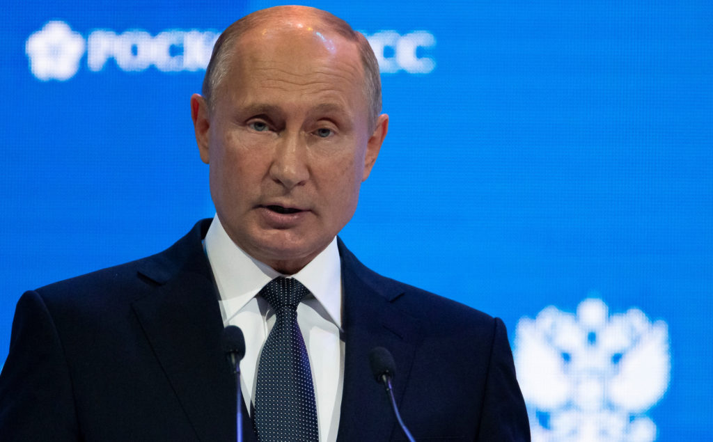 Russian President Vladimir Putin delivers a speech during a session of the Russian Energy Week international forum in Moscow, Russia October 3, 2018. Alexander Zemlianichenko/Pool via REUTERS - RC18BC682480