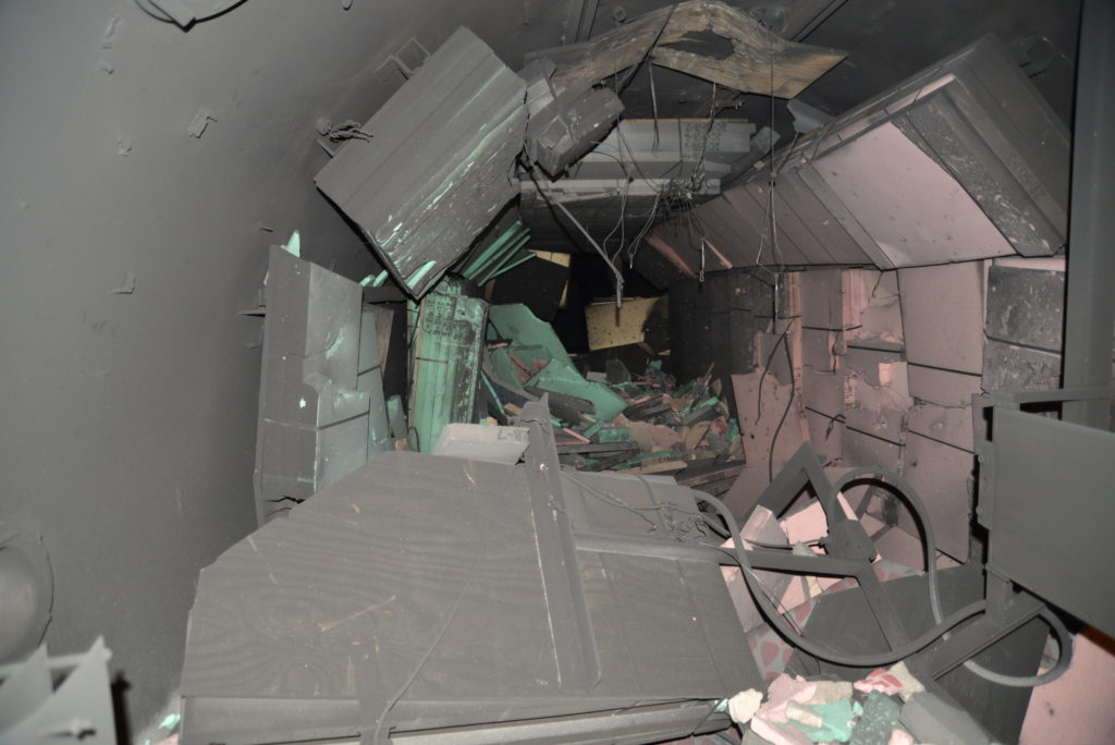 The tunnel used for the impact test was lined with foam slabs to catch pieces of debris. They did not all survive the explosion. Image courtesy of the Aerospace Corporation