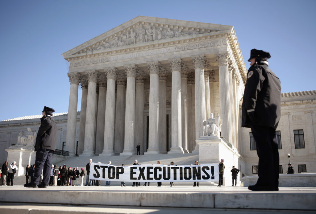 Protesters calling for an end to the death penalty unfurl a banner before police arrest them outside the Supreme Court in Washington, D.C., in 2007. Photo by Jason Reed/Reuters
