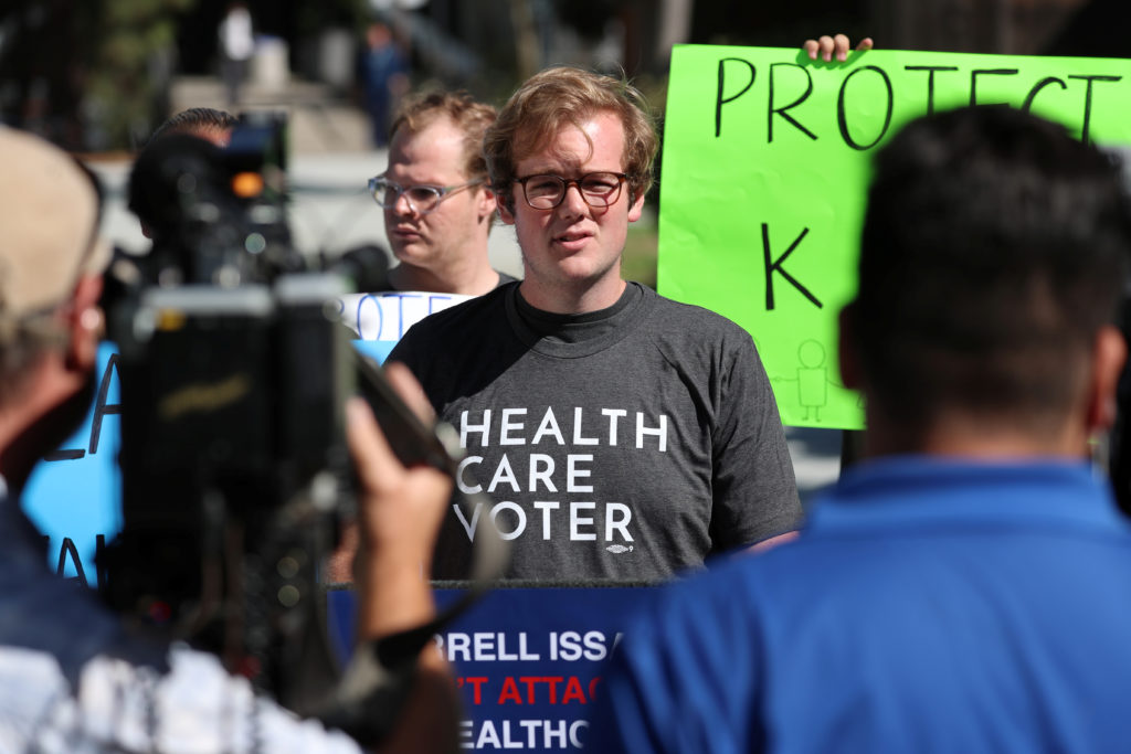 Student Aiden Beals speaks at a SoCal Health Care Coalition protest…