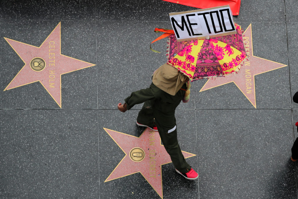 A demonstrator takes part in a #MeToo protest march for survivors of sexual assault and their supporters in Hollywood, Los Angeles, California U.S. November 12, 2017. Photo by Lucy Nicholson/Reuters