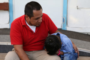 Walter Armando Jimenez Melendez, an asylum seeker from El Salvador, arrives with his four year-old son Jeremy at La Posada Providencia shelter in San Benito, Texas, shortly after he said they were reunited following separation since late May while in detention. Photo by Loren Elliott/Reuters