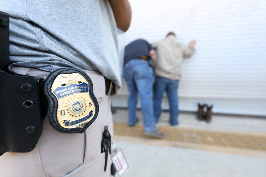 U.S. Immigration and Customs Enforcement's (ICE) Homeland Security Investigations (HSI) officers execute criminal search warrants and arrest more than 100 company employees on federal immigration violations at a trailer manufacturing business in Sumner, Texas, U.S, August 28, 2018.  Picture taken August 28, 2018.   U.S. Immigration and Customs Enforcement/Handout via REUTERS