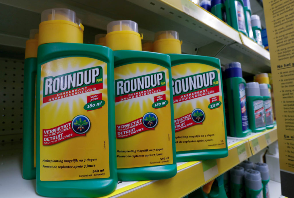 Monsanto's Roundup weedkiller atomizers are displayed for sale at a garden shop near Brussels, Belgium. Photo by Yves Herm...