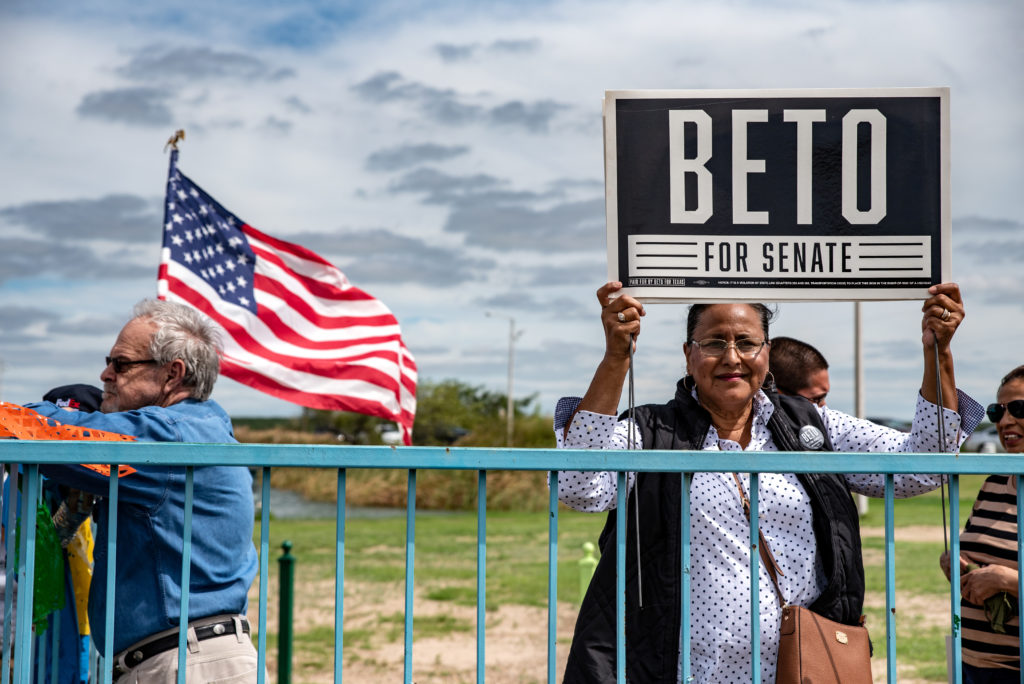A woman holds up a sign supporting Beto O'Rourke at an event in Eagle Pass, Texas. Photo by Sergio Flores/Reuters